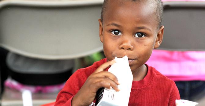 Families in Need little boy drinking milk