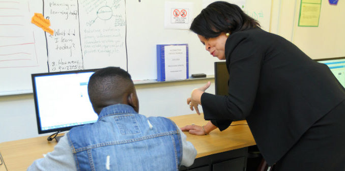 Darius Brown and teacher Rose Bolden work together. Photo by Dallas ISD