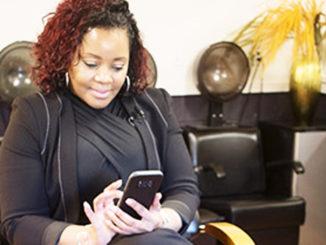 Black Woman Entrepreneur using Vivians app
