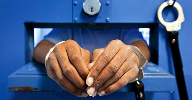 Youth hands   cell door